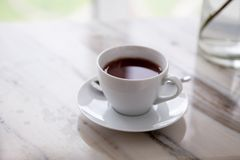 Cup of coffee on marble table Stock Photos