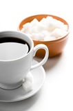 Cup of coffee and plate with sugar Stock Images