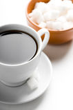 Cup of coffee and plate with sugar Royalty Free Stock Photo