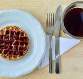 Cup of Coffee and plate with waffle Stock Image