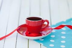 Cup of coffee on polka dot napkin Royalty Free Stock Image