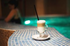 A cup of coffee in the pool royalty free stock photos
