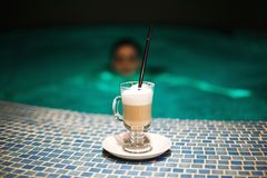 A cup of coffee in the pool stock photography