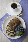 Cup of coffee and poppy seed strydel with blueberry Stock Photography