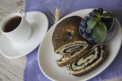 Cup of coffee and poppy seed strydel with blueberry Royalty Free Stock Images