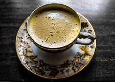Cup of coffee on porcelain saucer Royalty Free Stock Images