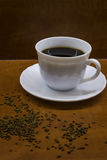 Cup of coffee. Porcelan cup of coffee on the brown table Stock Photo