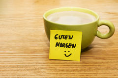 Cup of coffee, post-it note good morning and smiley Royalty Free Stock Images