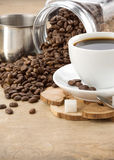 Cup of coffee and pot with beans Royalty Free Stock Image