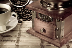 Cup of coffee, pot and grinder on vintage Stock Image