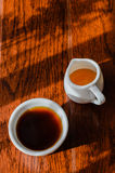 A cup of coffee and a pot of honey bee Stock Photo