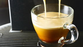 Cup of coffee poured stock footage