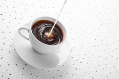 Cup of coffee with poured milk Stock Photography