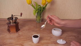 The cup of coffee poured sugar. The white cup of hot coffee with sugar added. Marble Table. White sugar bowl. stock video