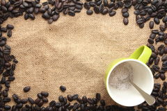 Cup of coffee powder with coffee bean frame Stock Images
