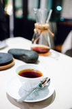 Cup of coffee prepared with a Chemex coffee maker. In a restaurant Royalty Free Stock Photo