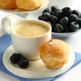 Cup of coffee with profiteroles and blueberries Royalty Free Stock Image