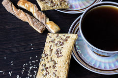 Cup of coffee with puff pastries with sunflower seeds, sesame seeds and flax. Royalty Free Stock Photo
