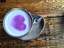 A cup of coffee with Purple Heart stock photography
