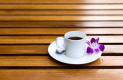 Cup of coffee with  purple orchid flower on Royalty Free Stock Photo