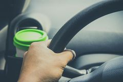 Cup coffee put on front console of a car Royalty Free Stock Images