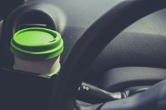 Cup coffee put on front console of a car Royalty Free Stock Photography