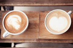 A cup of coffee put on wooden board Stock Photo