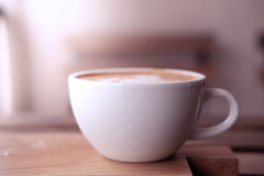 A cup of coffee put on wooden board Royalty Free Stock Image