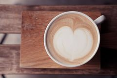 A cup of coffee put on wooden board Stock Images