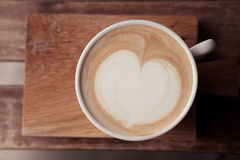 A cup of coffee put on wooden board Royalty Free Stock Photography
