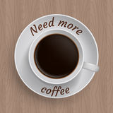 Cup of coffee with quote. Cup of coffee on table with quote 'Need more coffee Stock Photos