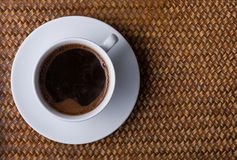 Cup of coffee on a rattan tray. View from top stock images