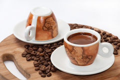 A cup of coffee with raw coffee beans Royalty Free Stock Image