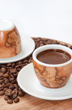 A cup of coffee with raw coffee beans Royalty Free Stock Photography
