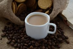 A cup of coffee. While reading a book, have  with cookies. Stop for a minute, coffee is a pleasure royalty free stock photo