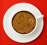 Cup of coffee on red. stock photos