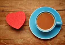 Cup of coffee and red box in heart shape Royalty Free Stock Image