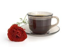 A cup of coffee and red flower Stock Photos