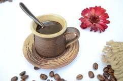 A cup of coffee with a red flower Royalty Free Stock Photos