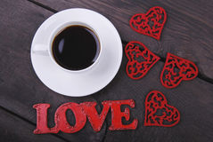The cup of coffee, red hearts and love text Royalty Free Stock Photo
