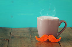 Cup of coffee with red mustache. Father& x27;s day concept Stock Photography