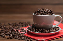 Cup of coffee on a red napkin Stock Images