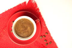 Cup of coffee on a red napkin Royalty Free Stock Images