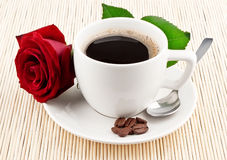 Cup of coffee and red rose. On textured background royalty free stock image