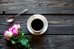 Cup of coffee with red rose and and copy space on wood background. breakfast on Mothers day, Women`s day Stock Photography