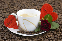 Cup of coffee, red rose and hearts Stock Photo