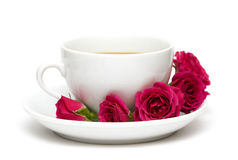 Cup of coffee with red roses stock image