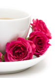 Cup of coffee with red roses Stock Images