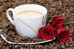 Cup of coffee and red roses Stock Images