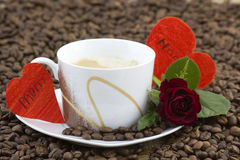 Cup of coffee, red roses and hearts Stock Images